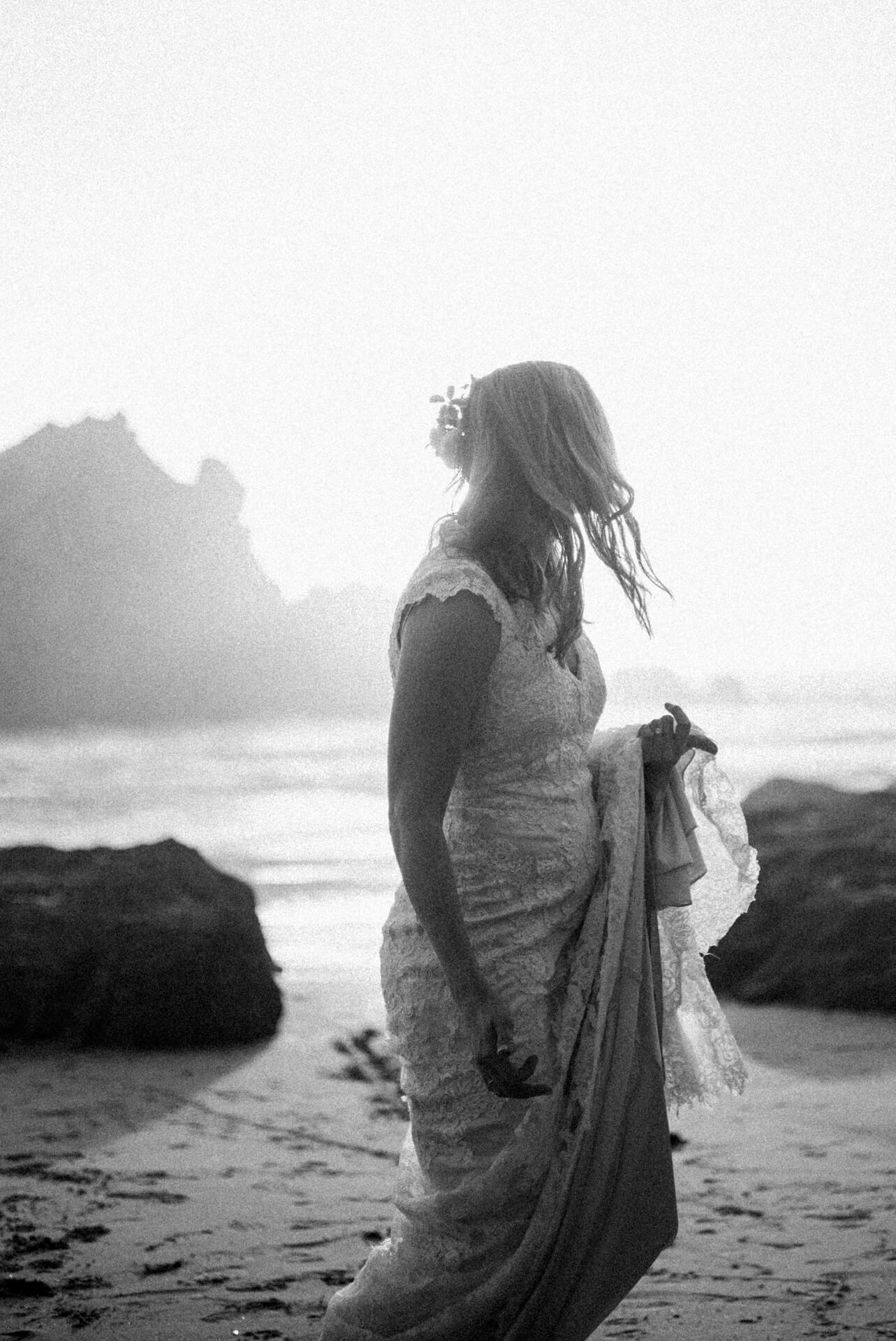 A bride on Pfeiffer Beach in Big Sur, California