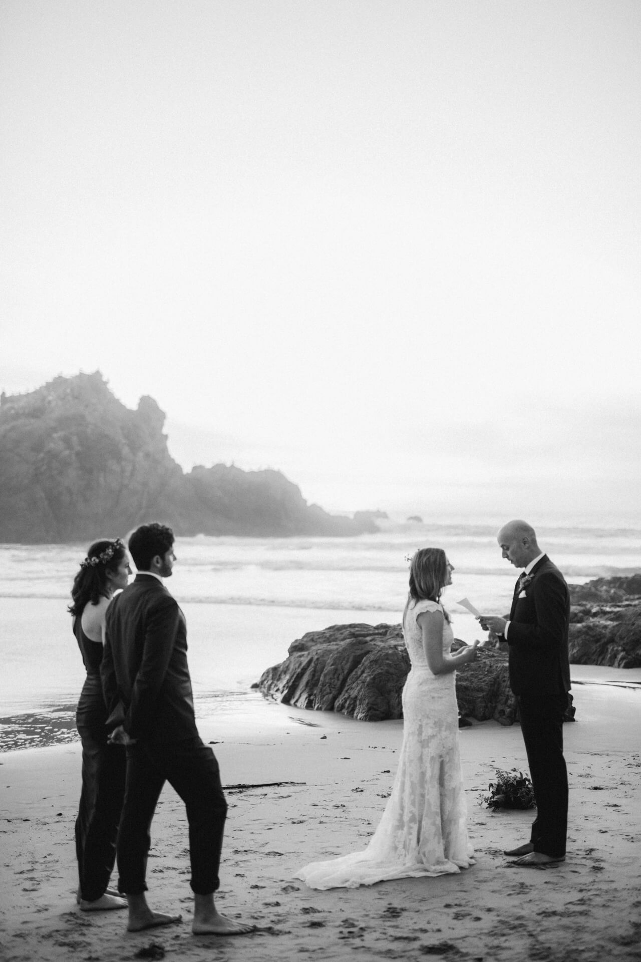 A couple exchanging vows on Pfeiffer Beach