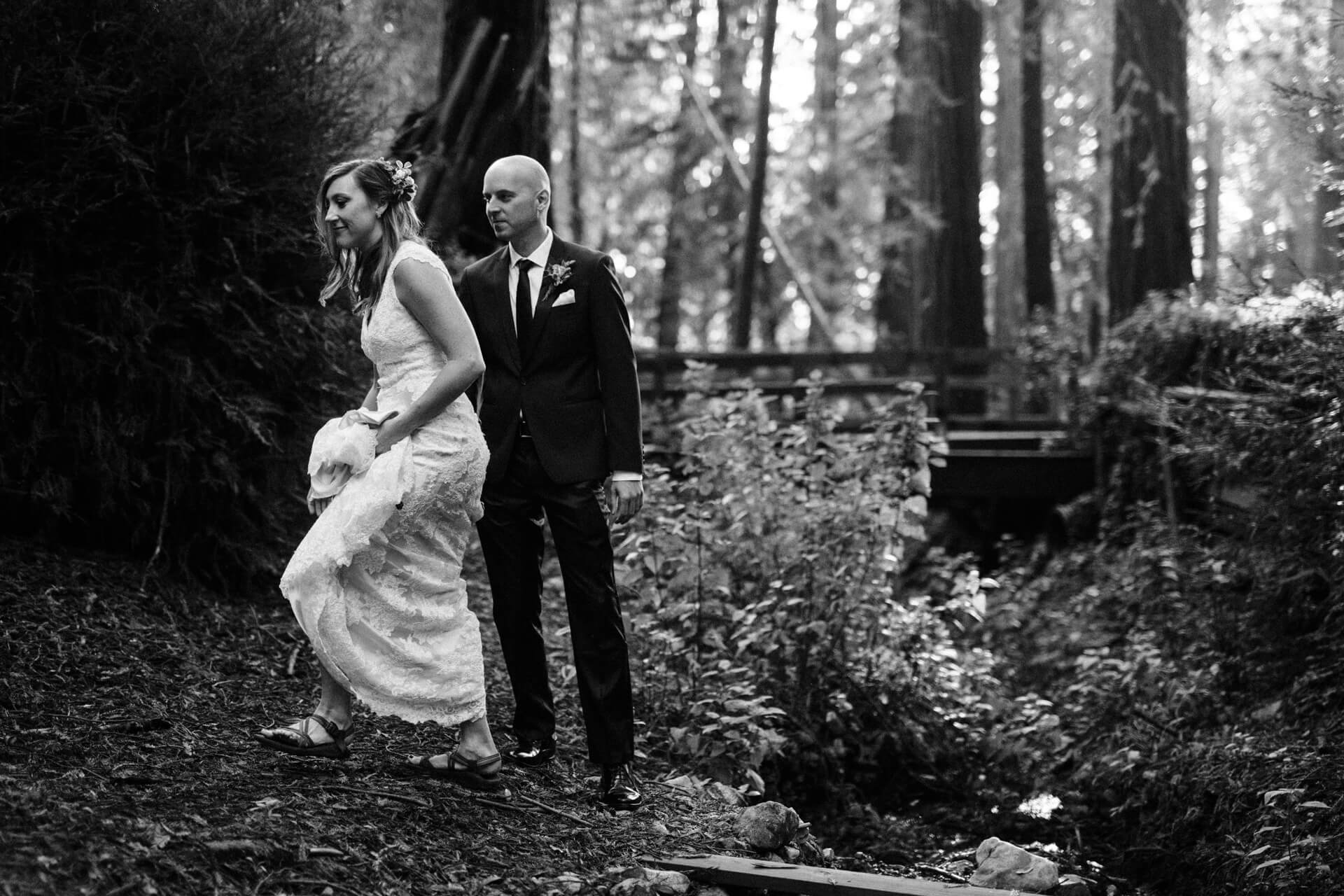 A couple walking before their elopement at Deetjens Inn in Big Sur, California
