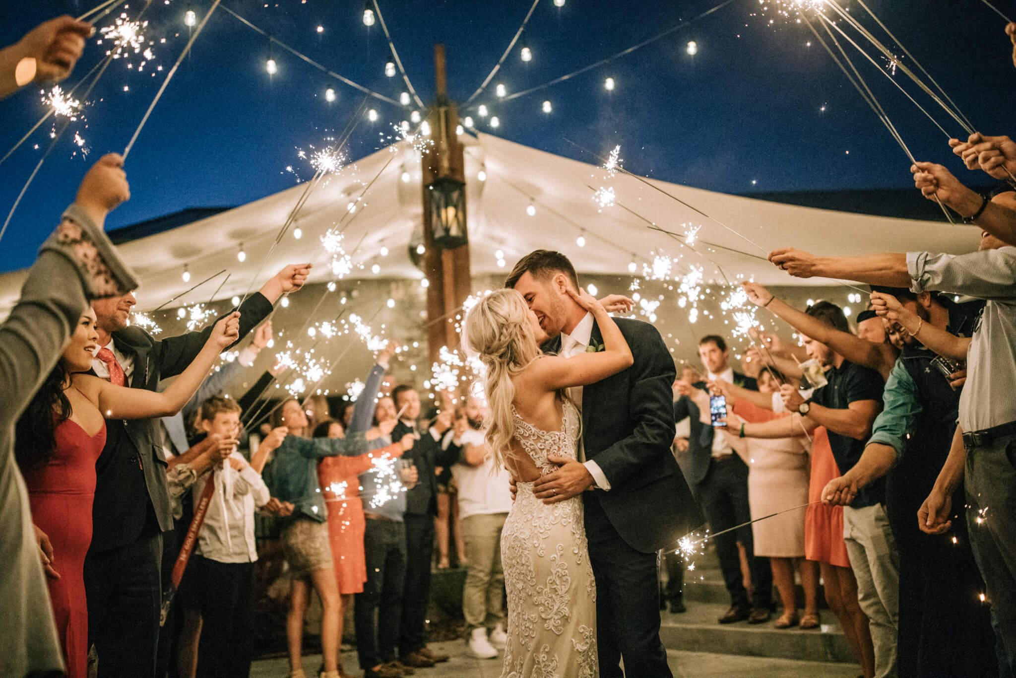 A sparkler send-off at a White Raven wedding outside Missoula, Montana